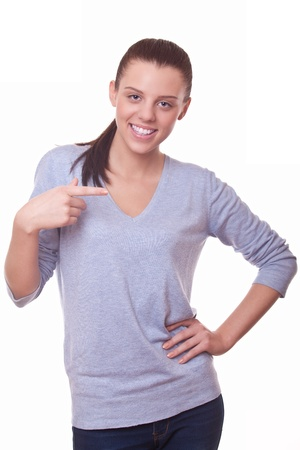 woman pointing her finger aside on white background Stock Photo - 16380248