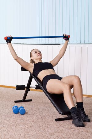 incline: woman training with dumbbells on incline bench
