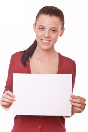 woman with blank board or paper for you advert photo