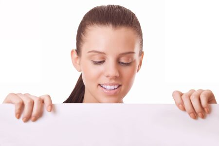 woman looking at blank board on white background photo