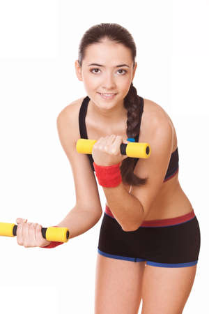 young woman doing fitness exercises with weights