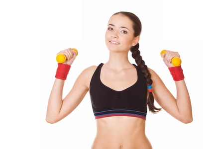 young fitness woman lifting dumbbells, isolated on white