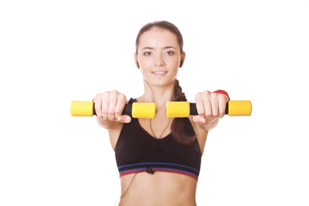 fitness woman lifting dumbbells during exercising, in focus only dumbbells