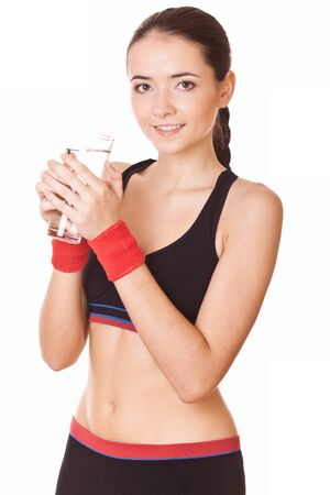 sporty woman with glass of water after fitness workout Stock Photo