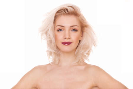 closeup portrait of young beautiful blonde woman on white background