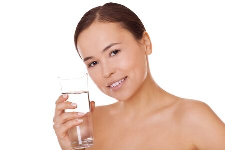 closeup woman with glass of water in hand, concept healthy life and nutrition photo