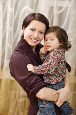 mam: happy mother holding child in her arms. mam loves daughter Stock Photo