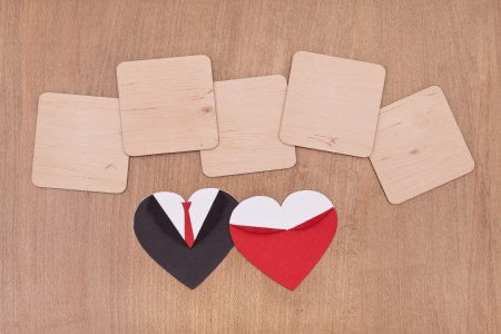 empty wooden plank with black and red hearts on wooden background photo