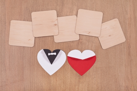 empty wooden boards with white and red hearts on wooden background photo