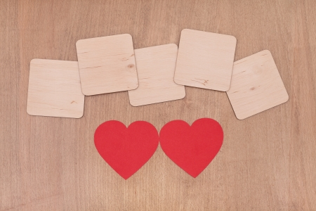 blank wooden boards and two red hearts, valentines day background photo