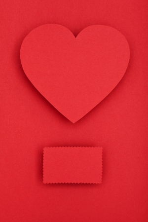 red paper heart on red background, valentines day theme photo