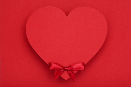valentines day background red heart and red bow on red background photo