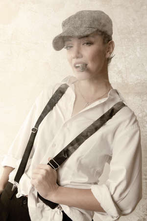 woman smoking cigars. vintage styled. studio fashion shot photo