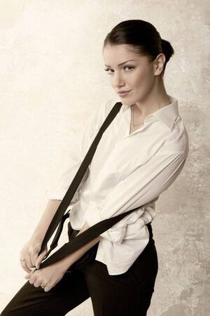 woman in shirt with suspenders. vintage styled. studio fashion shot photo