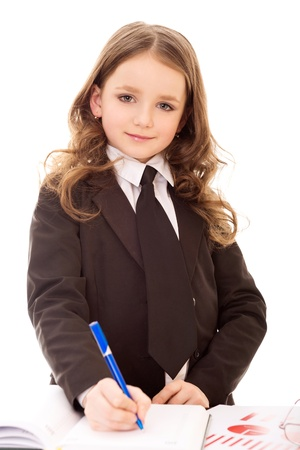 little business girl write in notepad and look at camera isolated on white background photo