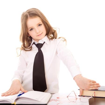 little girl dressed as confident business woman isolated on white background photo
