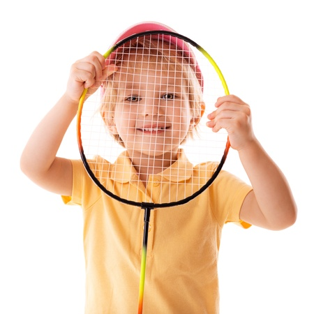 little girl plays with racket for badminton over white Stock Photo