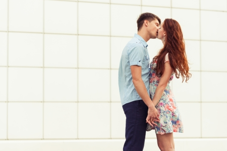 kissing young couple. romantic family portrait
