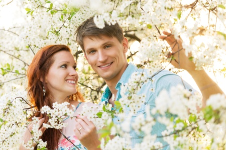 romantic couple in flower garden. positive outdoors photo photo