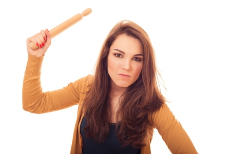 rollingpin: how angry woman with rolling-pin.  bright emotional portrait in studio