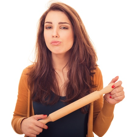 rollingpin: woman holds rolling-pin.  bright emotional portrait in studio