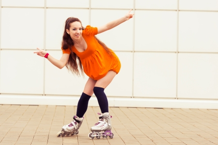 blading: girl  rollerblading in street city. active lifestyle