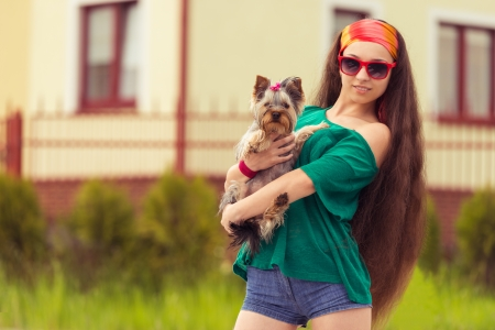 yorky: girl in sunglasses with dog