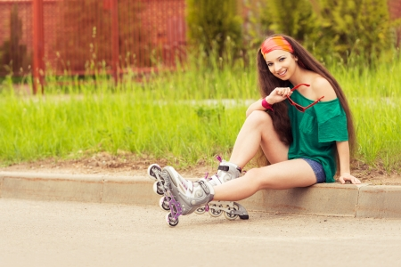 blading: girl holds red sunglasses and smiling on a sunny day