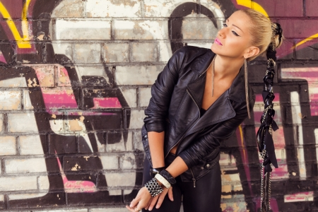glam rock: closeup photo girl in glam rock style over wall with graffiti Stock Photo