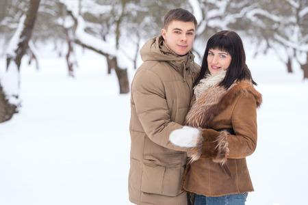 winter park: Couple in winter. Outdoor portrait
