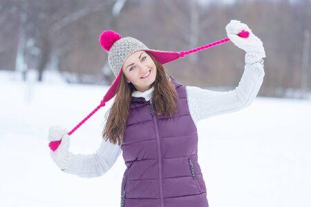 outdoor photo: Joyful smiling girl in winter park. Outdoor photo