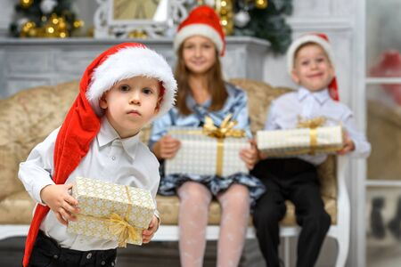 happiness christmas family concept - boy with x-mas gift box and smiling children Stock Photo