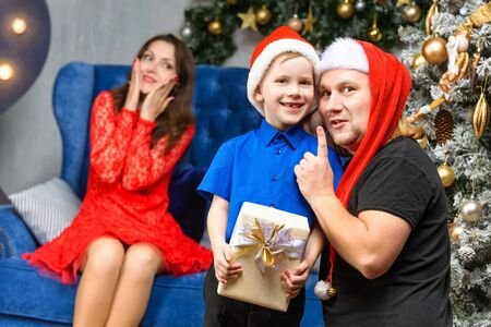 happiness christmas family concept - father and son with x-mas gift box