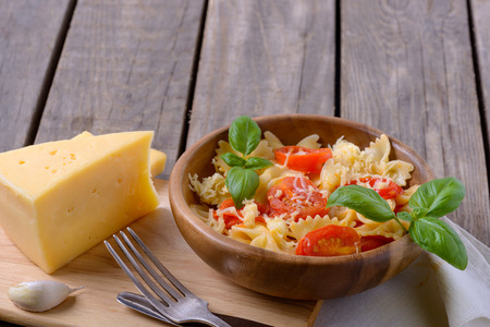 stirred: Tasty pasta with tomatoes and cheese. Copy space for text or recipe