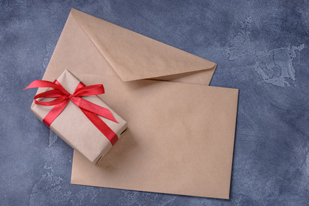 Gift box and blank two brown envelope with space for text