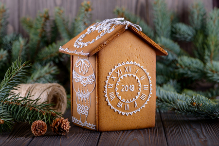 Homemade christmas gingerbread house on new year background