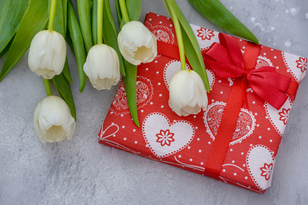 Gift box and white tulips. Template for mothers day greetings card