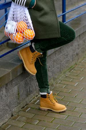 Yellow stylish womans boots. Street autumn fashion Stock Photo
