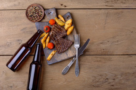 Steak and beer and potato. Top view with copy space Stock Photo