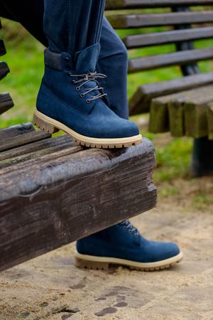 Blue boots on mens legs. Street fashion