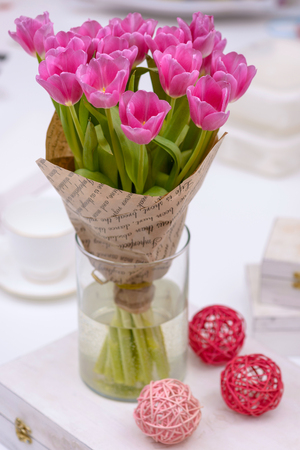 Bouquet tulips in vase. Holiday background for greetings card