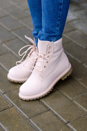 Close-up pink boots on womans legs. Street fashion Stock Photo