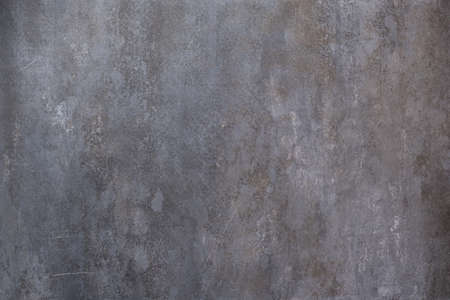Dark grunge stone textured wall closeup