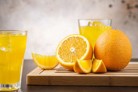 Close-up orange fizzy lemonade or juice with fruit. Lemonade in glass. Copy space for text Stock Photo