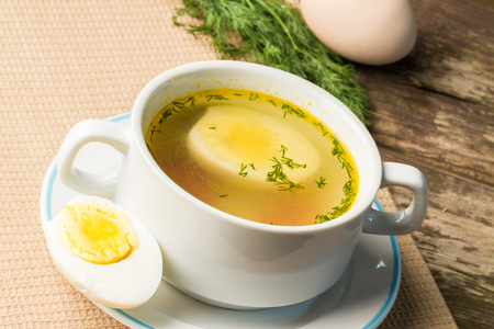 broth: Home-made fresh chicken broth in a soup cup.