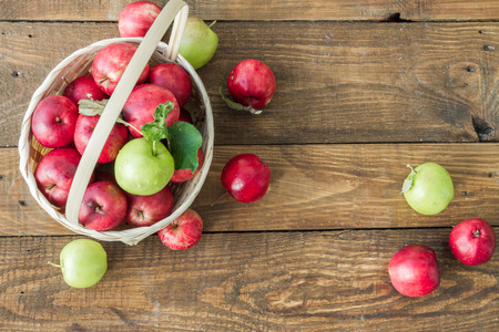 Variants of red and green apples in baskets. Stock Photo