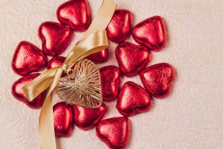 St. Valentines Day heart and sweets in a red brilliant wrapper. Stock Photo