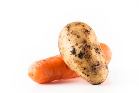 Ripe one potato and one carrot on white background. Close up. 版權商用圖片