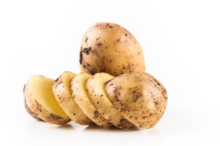 Organic sliced potatoes on a white background. Close up.