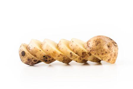 One ripe sliced potato on a white background. Close up.